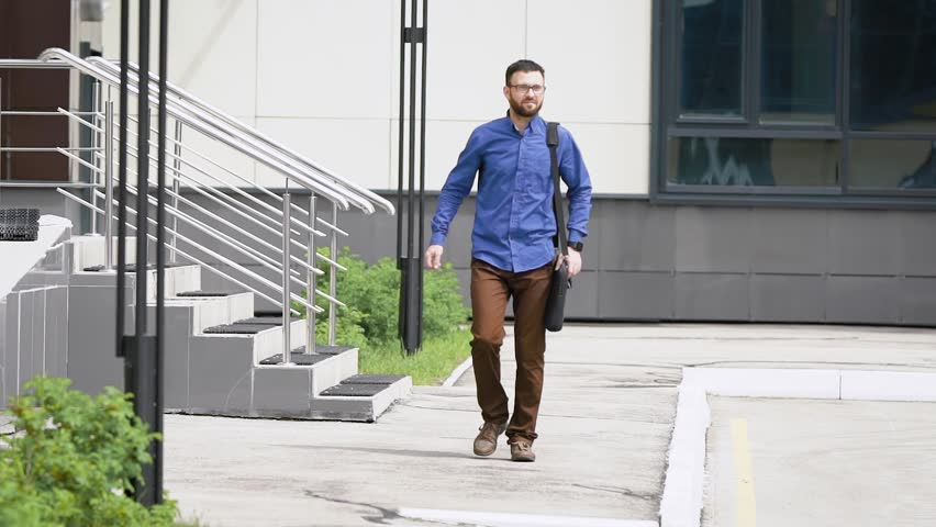 Confident businessman walking on street. Successful male entrepreneur walking on street at office building with confidence. | Shutterstock HD Video #28336606