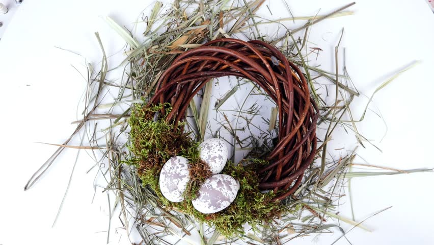Close-up, view from above, rotation, Easter composition, wreath of willow branches, decorated with moss and quail eggs | Shutterstock HD Video #28349236