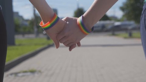 holding hands with LGBT symbols