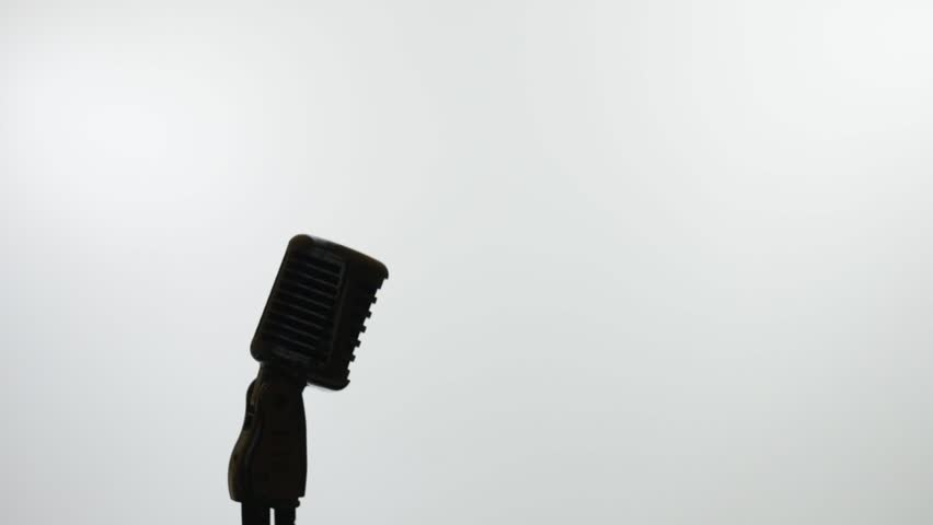 Retro microphone and silhouette of woman on white. Selective focus on mic | Shutterstock HD Video #28398676