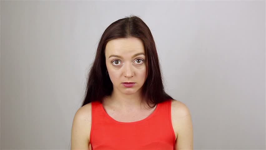 Young beautiful woman full of fury, looking at camera. Swears | Shutterstock HD Video #28464316