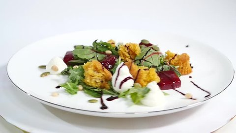 Cucumber salad with grilled tuna. Arugula and Beet Salad with Goat Cheese and Candied Nuts. Salad of lettuce, beetroot and salmon fillets with a delicate cream sauce