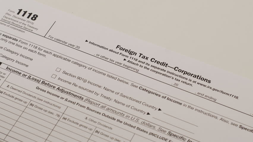 An Anonymous Person Reading The IRS Form 8965 Used To Obtain A ...