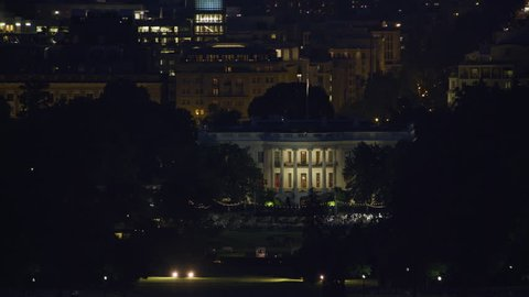 Washington, D.C. circa-2017, Aerial view as Washington Monument passes by White House at night. Shot with Cineflex and RED Epic-W Helium.