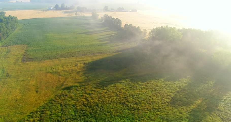 Breathtaking aerial view of farm fields through foggy sunrise.  | Shutterstock HD Video #28516825