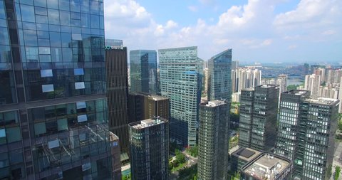 aerial view of drone flying over beautiful new modern Chengdu City with many high office buildings