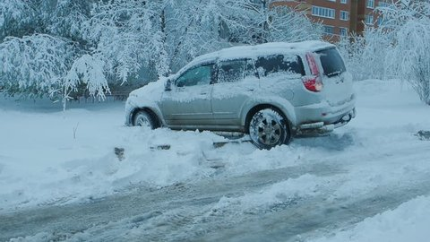 Car wheels riding on deep snow at winter season