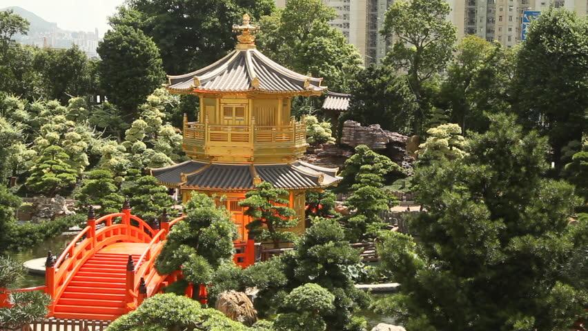 Red Wooden Arch Bridge and Golden Pavilion in Nan Lian Garden, Hong Kong.