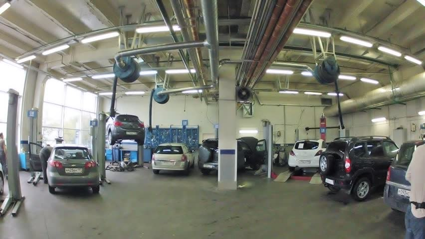 MOSCOW - AUG 27: (Timelapse View) Cars stand in garage of service center of Automobile Dealership Automir, on on Aug 27, 2012 in Moscow, Russia. Automir represents 21 leading automobile brands