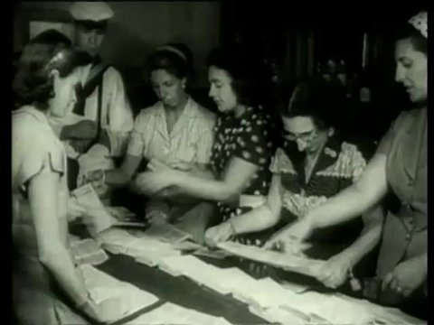 Female workers collect ballot papers after an election Argentina circa 1958-MGM PICTURES, UNIVERSAL-INTERNATIONAL NEWSREEL, USA, filmed in 1958