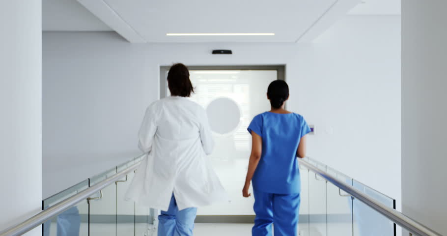 Doctor and nurse running in passageway of hospital during emergency | Shutterstock HD Video #28633843