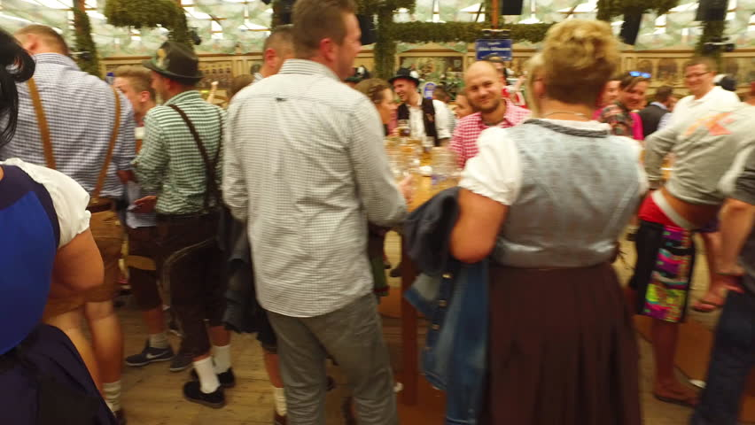 Munich, Germany-2010s: A beer maiden delivers armfuls of beer at Oktoberfest, Germany.