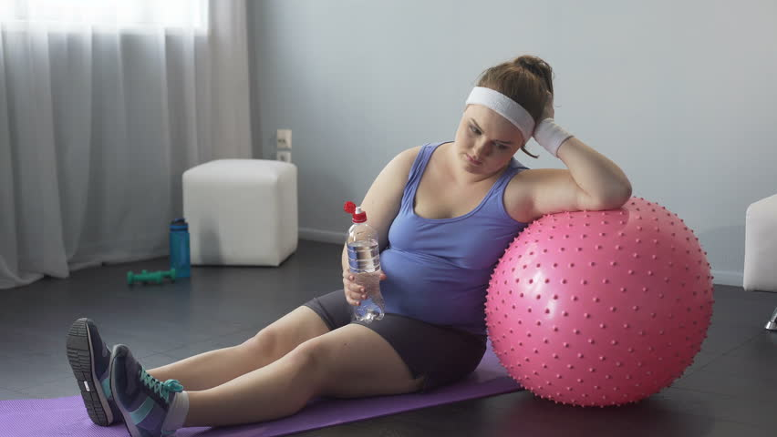 Fat woman upset about her weight, unsuccessful training, restoring water balance