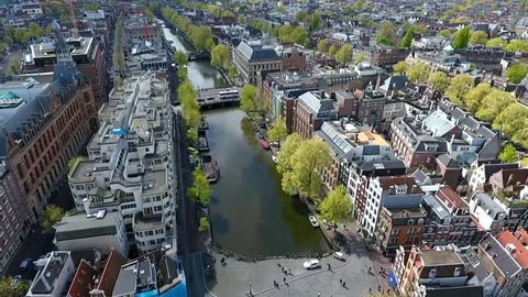 Amsterdam canal shot with a drone, rising up