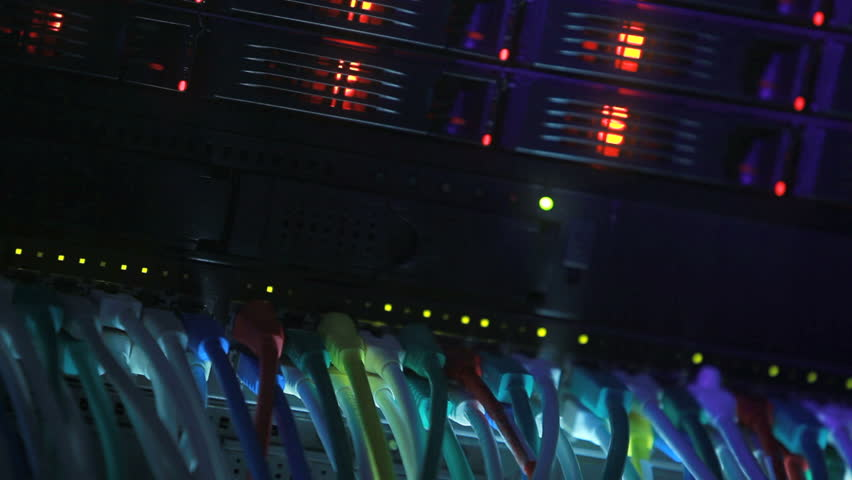 Server Rack and Network Hub cables with flickering lights toned in blue color