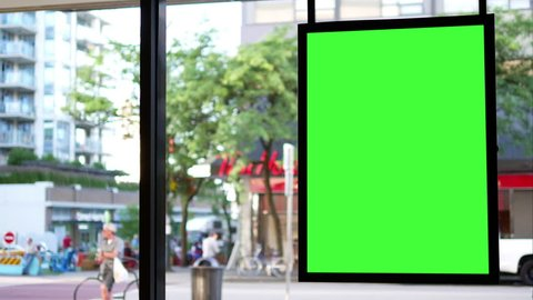 Motion of green screen for your ad beside of mall entrance with 4k resolution.