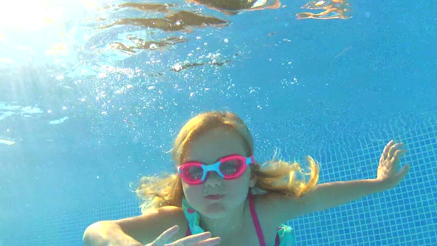 Underwater view young girl wearing goggles waving at camera. | Shutterstock HD Video #2873053