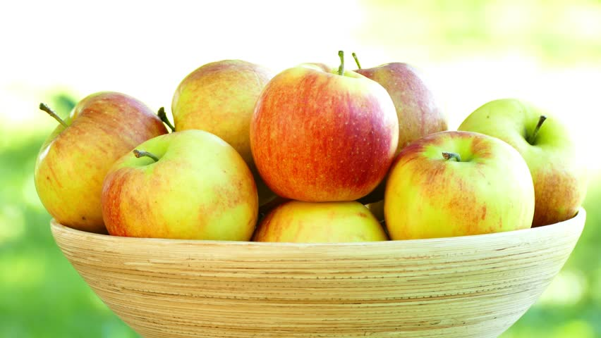 green and red apples in basket. ripe apples in basket, tilt down, uhd - 4k stock footage clip green and red basket