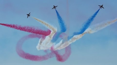 WESTON, ENGLAND - June 17: Slow Motion Red Arrows RAF (Royal Air Force) 'Figure of 8' Formation at Airshow Display on June 17 2017 in Weston Super Mare, England.