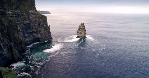 Aerial drone view fly off Cliffs of Moher