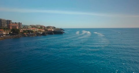 Aerial shot in Catania following Jet Skis