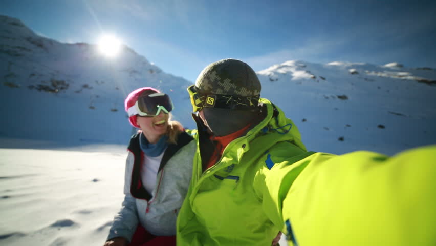 Couple taking selfie on ski slope Young couple takes selfie on ski slopes, Swiss Alps | Shutterstock HD Video #28868209