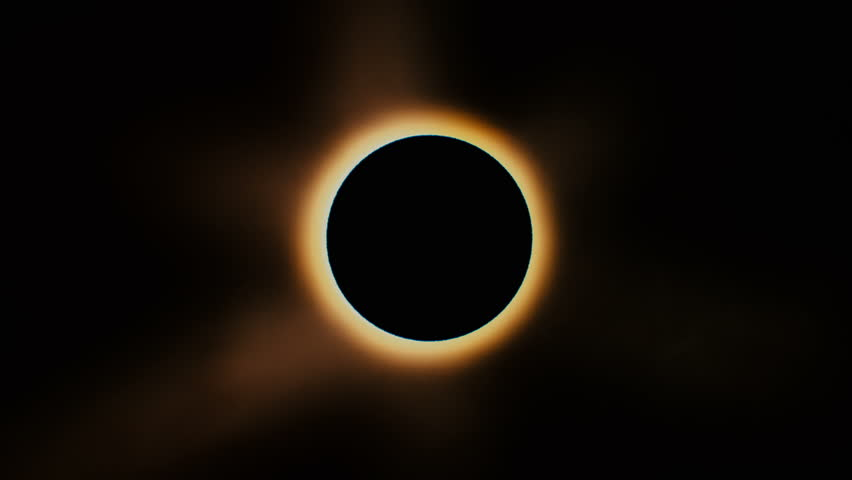 Full solar eclipse. The Moon mostly covers the visible Sun creating a diamond ring effect. This astronomical phenomenon can be seen as a sign of the End of the World. | Shutterstock Video #28907413