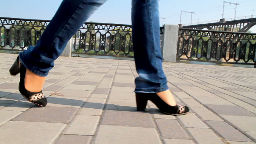 Tall, leggy girl is on the waterfront.  | Shutterstock HD Video #2891056