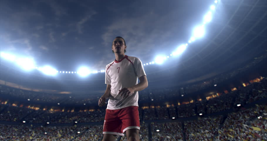 Footage of a soccer player in dramatic play during a soccer game on a professional outdoor soccer stadium. Player wears unbranded uniform. Stadium and crowd are made in 3D. | Shutterstock HD Video #28910686