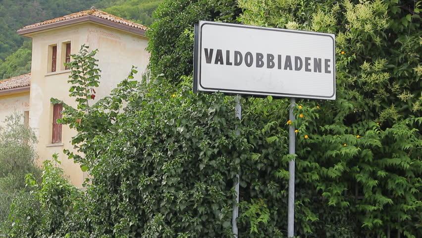 Village of Valdobbiadene road sign, where Prosecco is cultivated and produced. Prosecco Superiore di Conegliano-Valdobbiadene is a DOCG wine made with Glera grape in the province of Treviso.