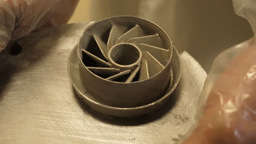 3D printed iron product. Young designer engineer using a 3D printer in the laboratory and studying a product prototype, technology and innovation concept