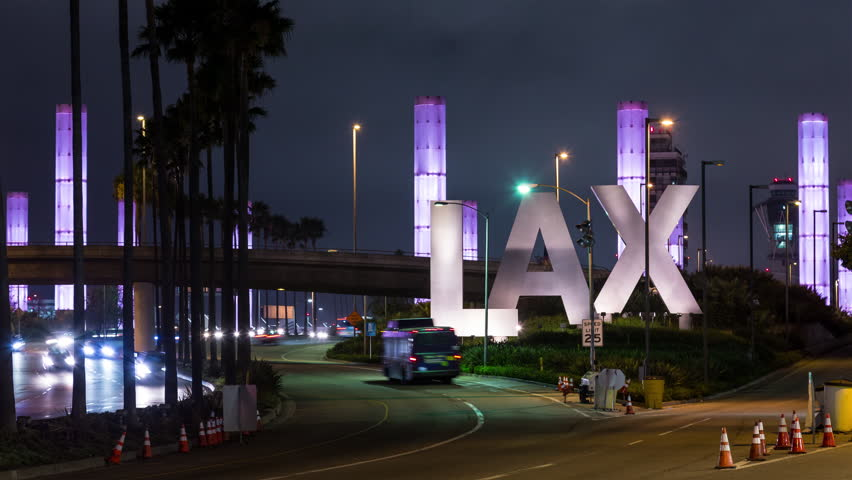 Los Angeles, California, USA - July 13th 2017 - Los Angeles International Airport LAX Sign and Traffic Night Timelapse