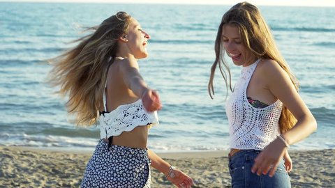 cdd2aa105 Cute Girls On Beach Moving Stock Footage Video (100% Royalty-free ...