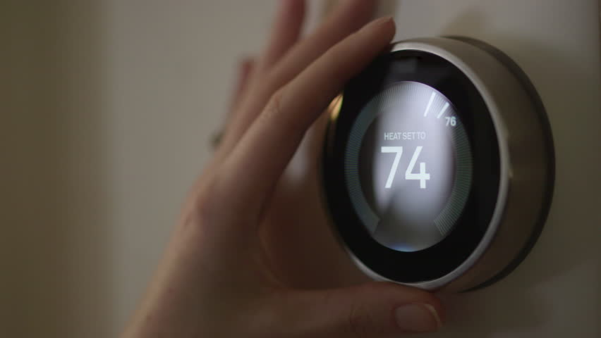 Woman Adjusting Smart Thermostat Gadget At Home | Shutterstock HD Video #28941796