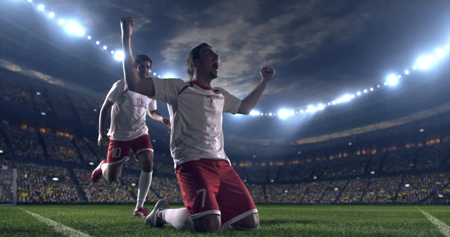 Professional footballer is happy and slides with his hands to the air. Another soccer player runs after him happily. Action takes place on soccer stadium.  Stadium and crowd are made in 3D. | Shutterstock HD Video #28948246