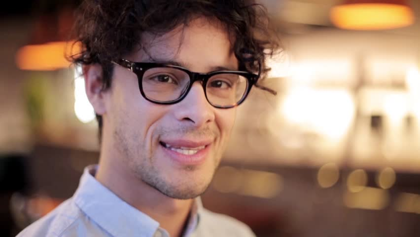 People, emotion and facial expression concept - face of happy smiling man in glasses | Shutterstock HD Video #28965031