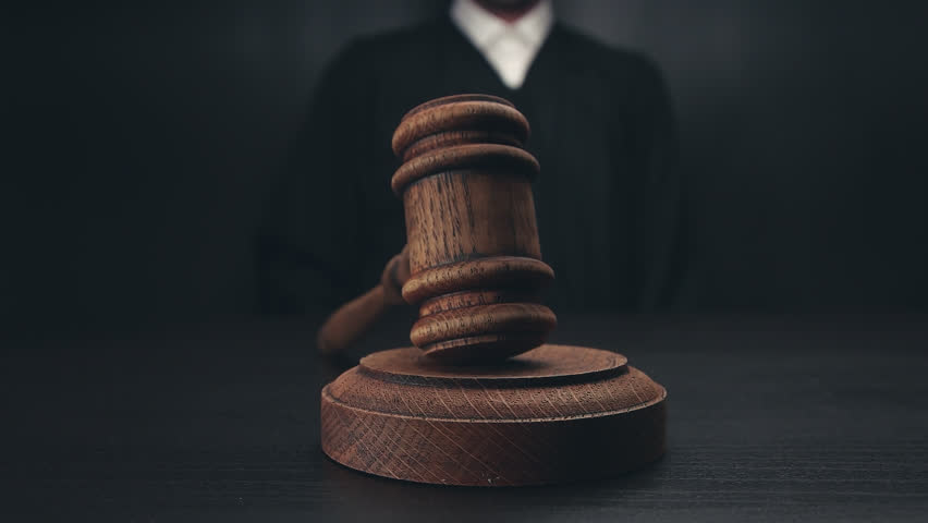 Male judge in a courtroom | Shutterstock HD Video #28983916