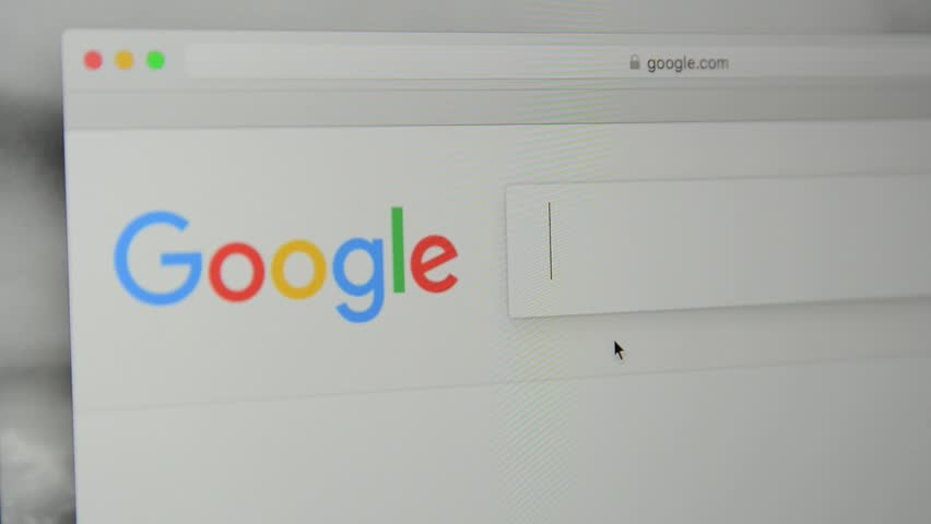 """Milan, Italy - July 6, 2017: Google.com homepage. Typing words """"sex robot"""" in Google's search bar."""