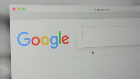 "Milan, Italy - July 6, 2017: Google.com homepage. Typing words ""sex robot"" in Google's search bar."