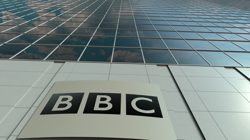 Signage board with British Broadcasting Corporation BBC logo. Modern office building facade time lapse. Editorial 3D rendering
