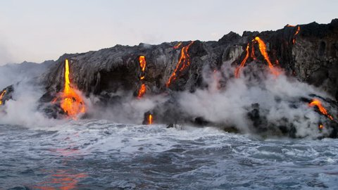 Red hot lava pouring into the Pacific ocean from erupting Kilauea volcano at night Hawaii at dawn USA RED EPIC