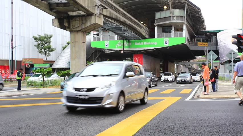 KUALA LUMPUR  MALAYSIA   JULY 2017   Car and people along Traffic city  streetDay Push Green Canopy Covered Entrance Raked Left 14 Story Red  . Brick Apartment Building Entrance. Home Design Ideas