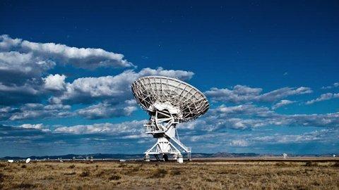 cloudy sky above dish antenna
