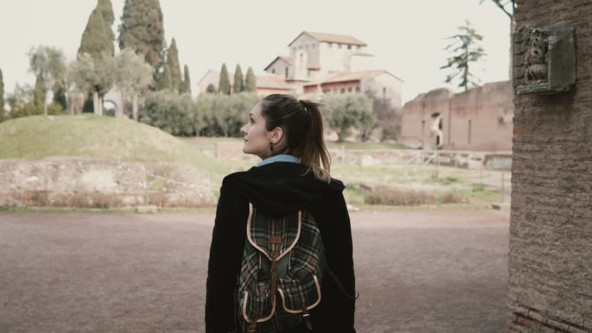 Pretty young girl is walking around Rome, Italy, seeing over an antique. The tourist is exploring the ancient ruins. | Shutterstock HD Video #29051416