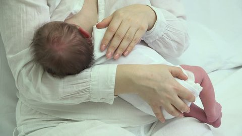 Newborn baby breastfeeding, perfect mother and child bounding