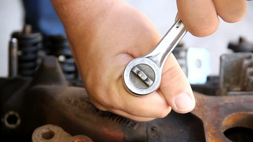 Two Male Hands Holding And Operating A Ratchet Closeup