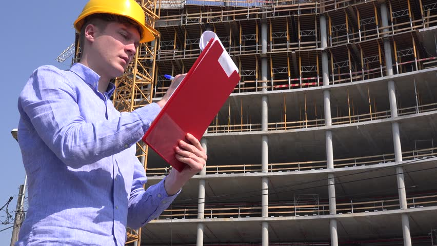 Architect profession reading blueprint construction plan builder handsome professional foreman writing blueprint plan engineering architect work 4k stock video clip malvernweather Image collections