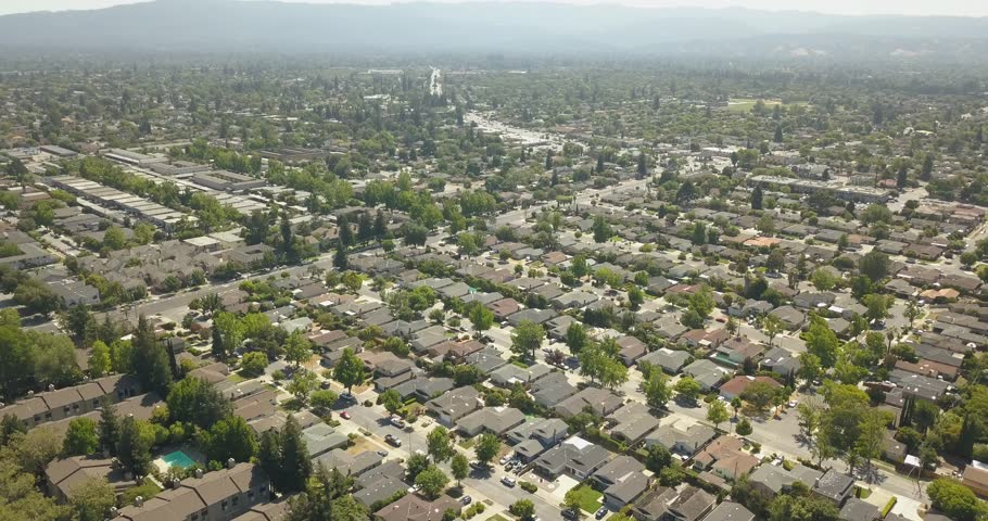 Drone footage over neighborhood, flying over San Jose California, high quality drone footage over houses.