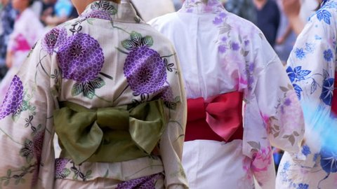 "Japanese women wearing traditional casual summer costume ""Yukata"" in summer festival"