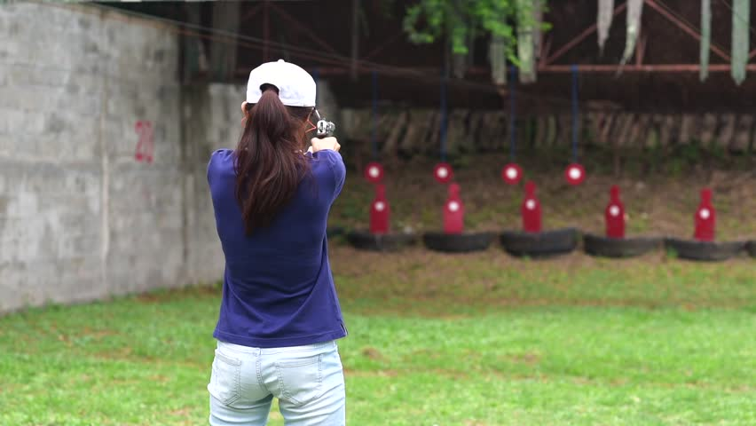 woman in practice of gun shooting in martial arts for self defense in an emergency case